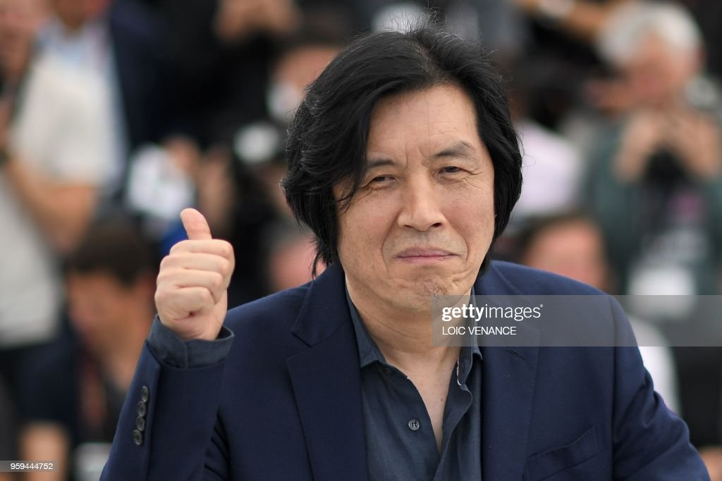 TOPSHOT - South Korean director Lee Chang-Dong poses on May 17, 2018 during a photocall for the film 'Burning' at the 71st edition of the Cannes Film Festival in Cannes, southern France.