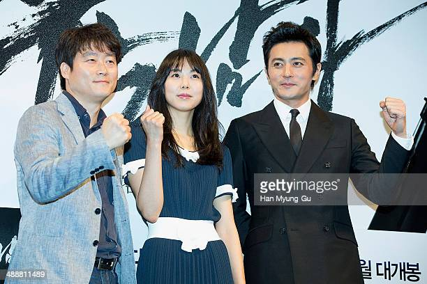 South Korean director Lee JungBum actors Kim MinHee and Jang DongGun attend No Tears For The Dead press conference at the CGV on May 8 2014 in Seoul...