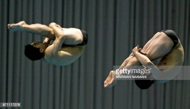 South Korean divers Kwon KyungMin and Cho KwanHoon perform in the final of the men's 3m sychronized dive event in Busan 09 October 2002 during the...