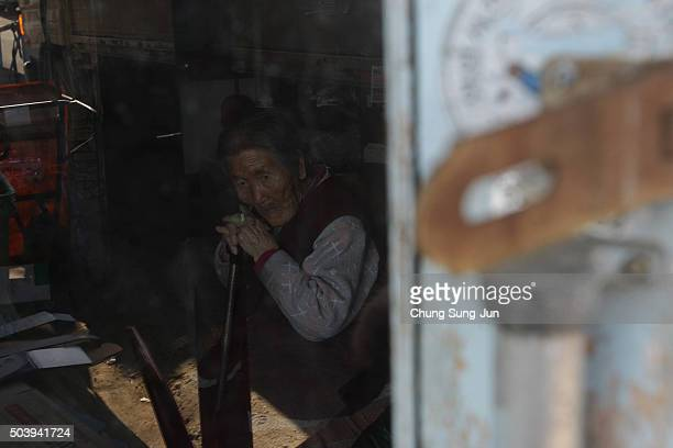South Korean elderly woman who lives near loudspeakers placed near the Demilitarized zone separating South and North Korea on January 8 2016 in Paju...