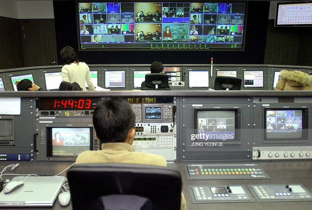 South Korean employees work at the controls at the satellite digital multimedia broadcasting (DMB) center in Seoul, 10 January 2005. South Korea launched trial operations of the world's first satellite-based television service for mobile phone users.
