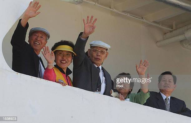South Korean family reunion members wave after boarding the Seolbong ferry prior to departing for North Korea in Sokcho about 270km northeast of...