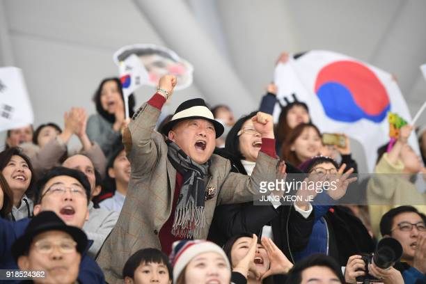 South Korean fans cheer on South Korea's Lee Seung-Hoon competing in the men's 10,000m speed skating event during the Pyeongchang 2018 Winter Olympic...