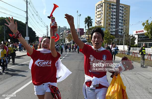 South Korean fans cheer outside the BeiraRio Stadium in Porto Alegre before a Group H football match between South Korea and Algeria during the 2014...