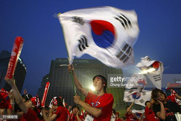 South Korean fans watch the public viewing of the FIFA World Cup Germany 2006 group G match between South Korea and Togo in front of City Hall on...