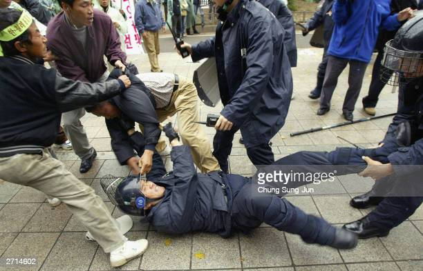 South Korean farmers clash with riot police during a FTA protest in front of the National Assembly November 10 2003 in Seoul South Korea More than...