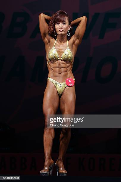 South Korean female bodybuilder Cho EunJin performs in the WFF Woman Class Two competition during the 2014 NABBA/WFF Korea Championship on April 13...