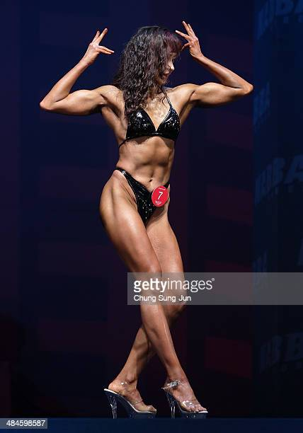 South Korean female bodybuilder Kim EunBi performs in the WFF Woman Class Two competition during the 2014 NABBA/WFF Korea Championship on April 13...