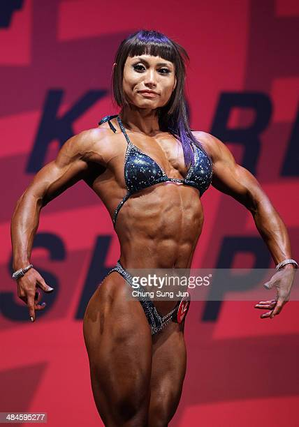 South Korean female bodybuilder Kim JiHyun performs in the WFF Woman Class One competition during the 2014 NABBA/WFF Korea Championship on April 13...