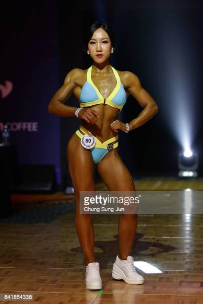 South Korean female bodybuilder Kim Min-Ah poses for judges in the Miss Sport Model-T during the 2017 NABBA/WFF Asia Final on September 2, 2017 in...