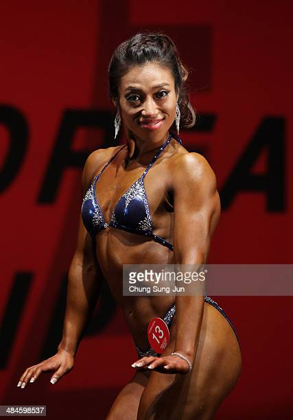 South Korean female bodybuilder Shim SoMin performs in the WFF Woman Class One competition during the 2014 NABBA/WFF Korea Championship on April 13...