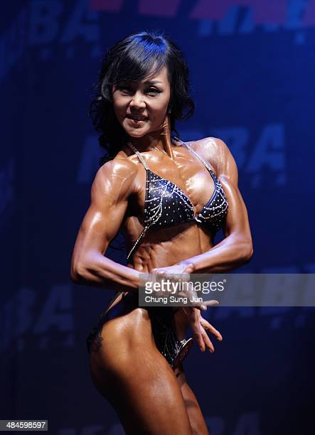 South Korean female bodybuilder Shin HyoJu performs in the WFF Woman Class One competition during the 2014 NABBA/WFF Korea Championship on April 13...