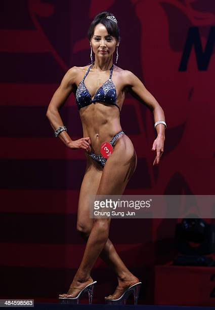 South Korean female bodybuilder Yoon SooJung performs in the WFF Woman Class Two competition during the 2014 NABBA/WFF Korea Championship on April 13...