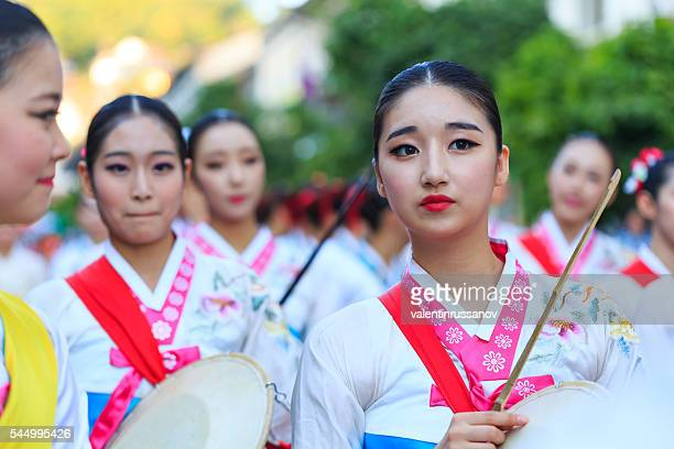 South Korean female musicians participating in festival's parade