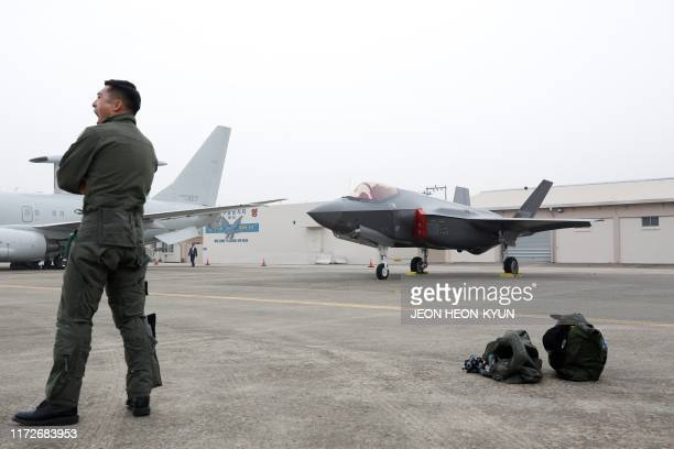 A South Korean fighter pilot stands next to a F35 A Stealth during the 71st anniversary of Armed Forces Day at the Military Air Base in Daegu on...