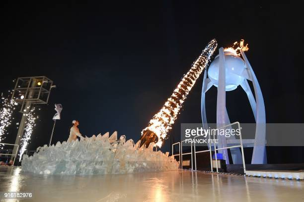 TOPSHOT South Korean figure skater Kim Yuna lights the cauldron with the Olympic Flame during the opening ceremony of the Pyeongchang 2018 Winter...