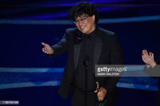 South Korean film director Bong Joon Ho accepts the award for Best Director for Parasite during the 92nd Oscars at the Dolby Theatre in Hollywood...