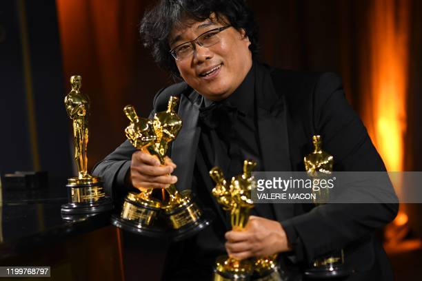 South Korean film director Bong Joon Ho poses with his engraved awards as he attends the 92nd Oscars Governors Ball at the Hollywood & Highland...