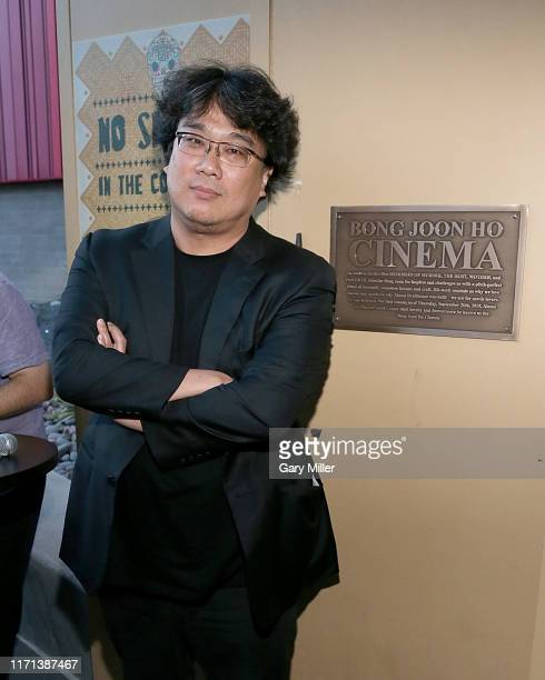South Korean filmmaker Bong Joon Ho stands next to a plaque renaming the South Lamar location the Bong Joon Ho Cinema in his honor during Fantastic...