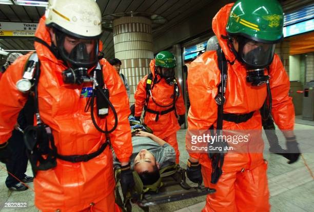 South Korean firefighters participate during an antichemical terrorism drill at a subway stations October 21 2003 in Seoul South Korea South Korean...