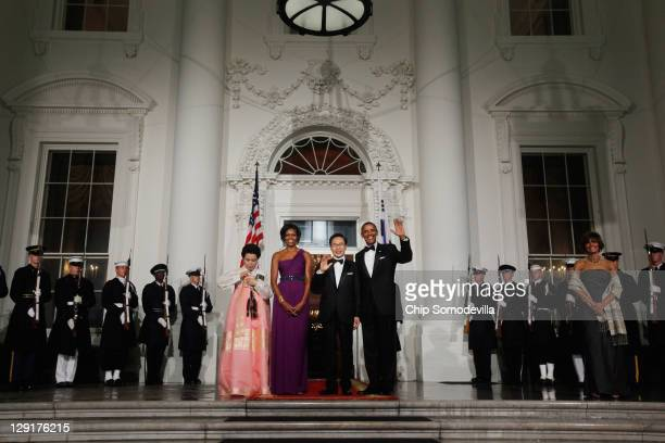 South Korean first lady Kim Yoonok US first lady Michele Obama South Korean President Lee Myungbak and US President Barack Obama pose for photographs...
