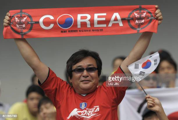 A South Korean football fan shows his support for his team before the 2008 Beijing Olympic Games first round Group D men's football match against...