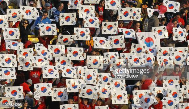 South Korean football fans cheer for their team before the start of the 2011 Asian Cup semi-final football match between Japan and South Korea at...