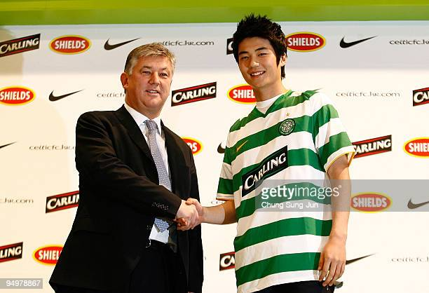 South Korean footballer Ki SungYueng shakes hands with Chief Executive of Celtic Peter Lewell during a press conference announcing he will be joining...