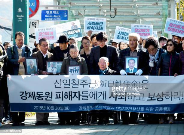 South Korean forced labour plaintiffs march to the Supreme Court on October 30 2018 in Seoul South Korea South Korean Supreme Court ordered Nippon...
