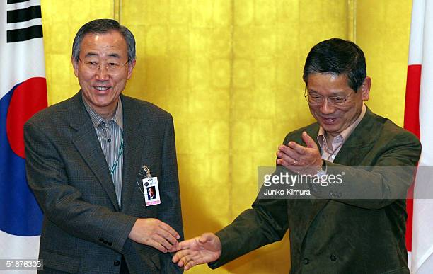South Korean Foreign Minister Ban Ki-Moon is welcomed by Japanese Foreign Minister Nobutaka Machimura prior to a foreign ministerial meeting on...