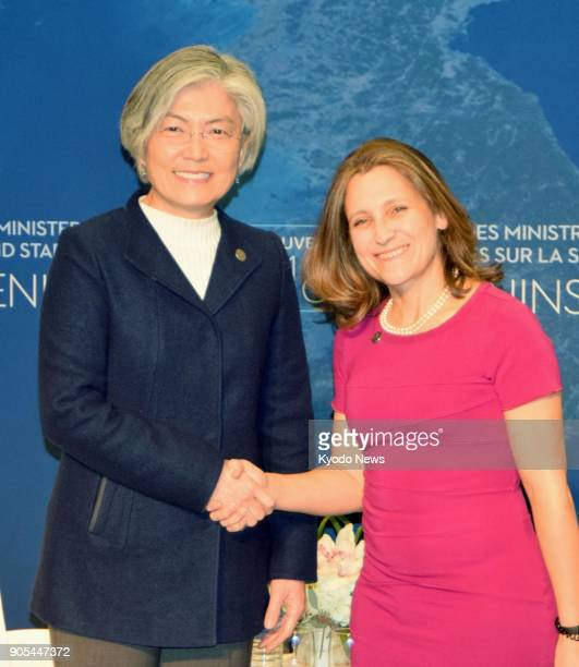 South Korean Foreign Minister Kang Kyung Wha and her Canadian counterpart Chrystia Freeland shake hands at the start of their talks in Vancouver on...