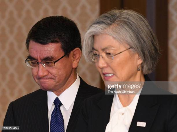 South Korean Foreign Minister Kang Kyungwha and Japanese Foreign Minister Taro Kono enter the room prior to their meeting at the Iikura Guest House...