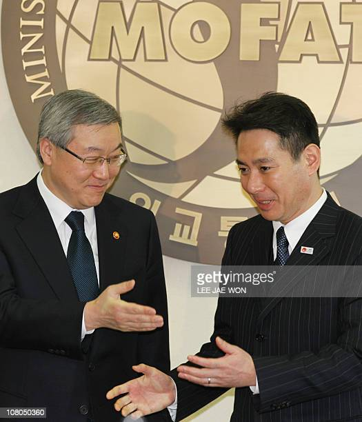 South Korean Foreign Minister Kim SungHwan greets visiting Japanese Foreign Minister Seiji Maehara during a photo call at the former's office in...