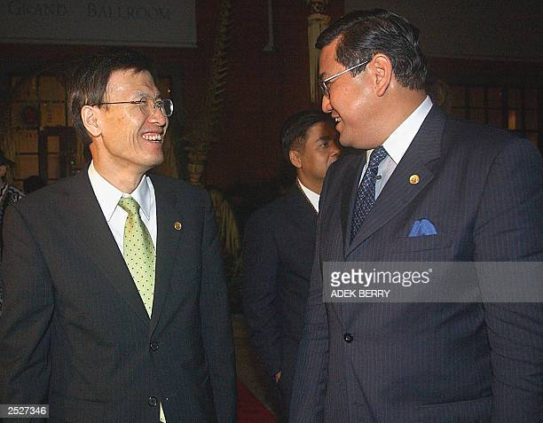 South Korean Foreign Minister Yoon YoungKwan shares a light moment with his Thai counterpart Surakiart Sathirathai after ministerial meetings for the...