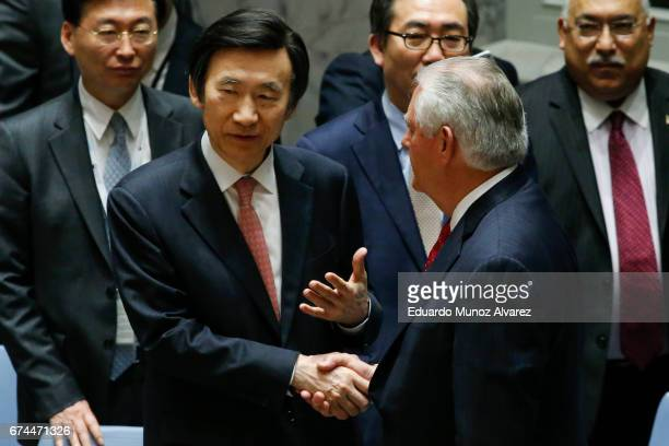 South Korean Foreign Minister Yun Byung Se shakes hands with US Secretary of State Rex Tillerson at the end of the security council meeting on...