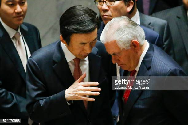 South Korean Foreign Minister Yun Byung Se speaks with US Secretary of State Rex Tillerson at the end of the security council meeting on...