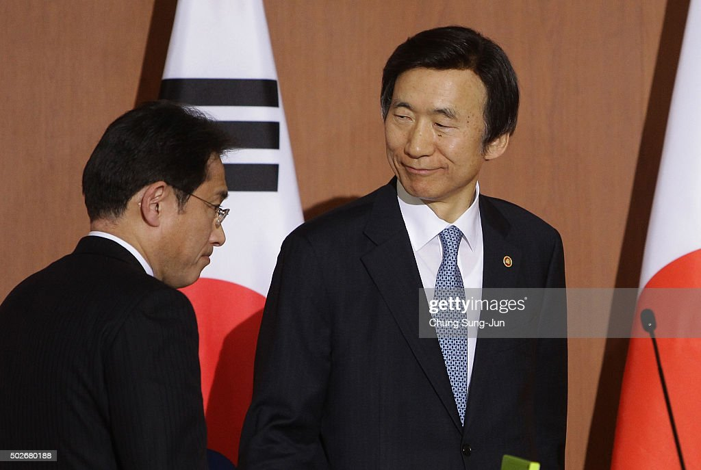 South Korean Foreign Minister Yun Byung-Se (R) and Japanese Foreign Minister Fumio Kishida (L) leave after joint press conference at foreign ministry on December 28, 2015 in Seoul, South Korea. South Korean Foreign Minister Yun Byung Se and Japanese Foreign Minister Fumio Kishida met to discuss the issue of Korean 'comfort women' in Japanese military brothels before and during World War II.