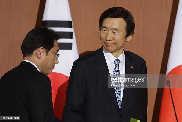 South Korean Foreign Minister Yun Byung-Se and Japanese Foreign Minister Fumio Kishida leave after joint press conference at foreign ministry on...