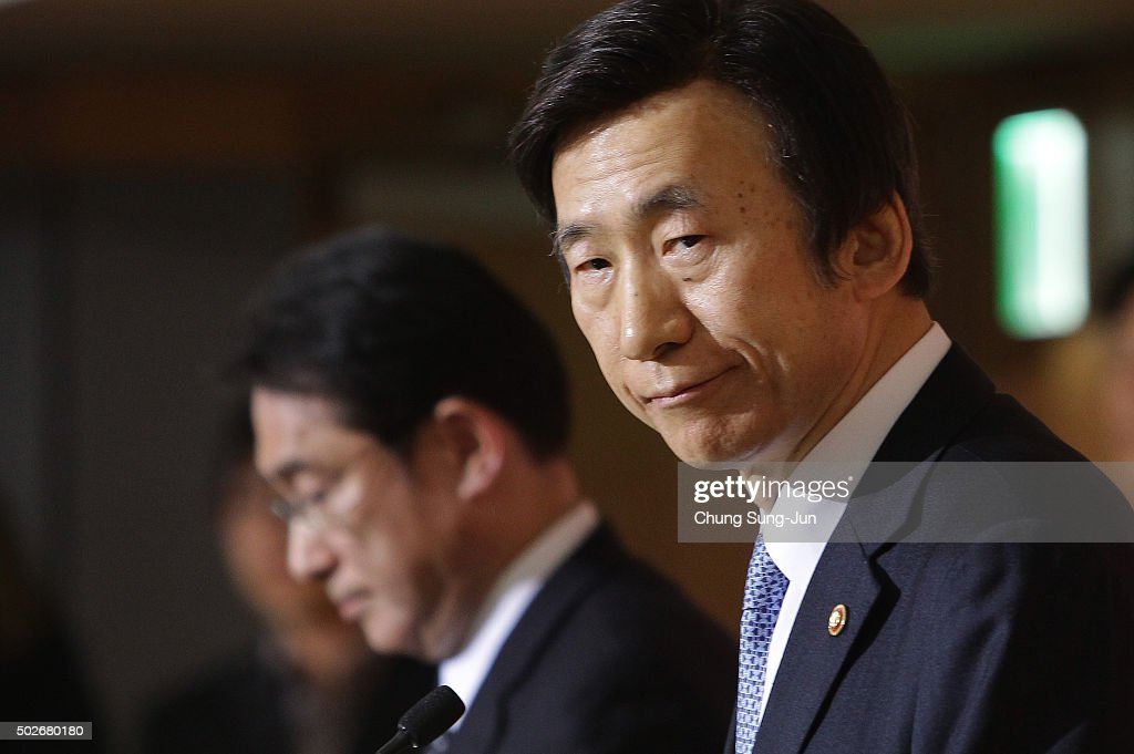 South Korean Foreign Minister Yun Byung-Se (R) attends the joint press conference with Japanese Foreign Minister Fumio Kishida (L) at foreign ministry on December 28, 2015 in Seoul, South Korea. South Korean Foreign Minister Yun Byung Se and Japanese Foreign Minister Fumio Kishida met to discuss the issue of Korean 'comfort women' in Japanese military brothels before and during World War II.