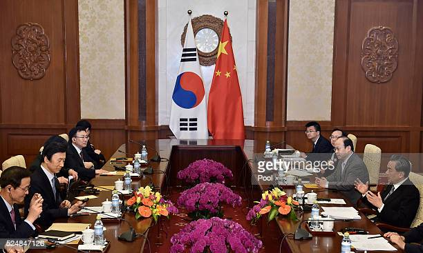 South Korean Foreign Minister Yun Byung-Se holds a talk with Chinese Foreign Minister Wang Yi during a meeting at the Diaoyutai State Guesthouse on...