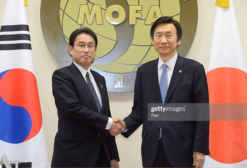 South Korean Foreign Minister Yun Byung-Se (R) shakes hands with Japanese Foreign Minister Fumio Kishida (L) before their meeting at foreign ministry on December 28, 2015 in Seoul, South Korea. South Korean Foreign Minister Yun Byung Se and Japanese Foreign Minister Fumio Kishida met to discuss the issue of Korean 'comfort women' in Japanese military brothels before and during World War II.