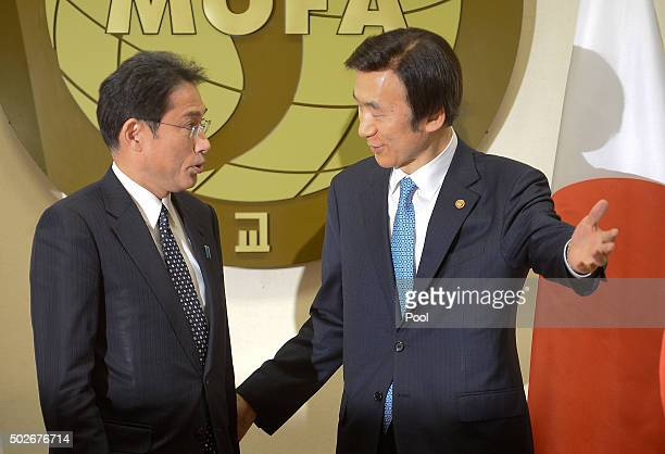 South Korean Foreign Minister Yun Byung-Se shakes hands with Japanese Foreign Minister Fumio Kishida before their meeting at foreign ministry on...