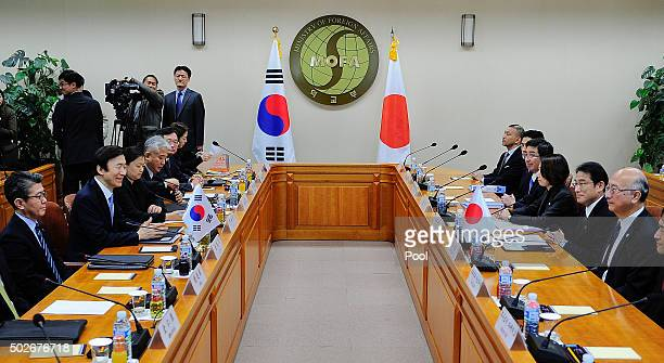 South Korean Foreign Minister Yun Byung-Se talks with Japanese Foreign Minister Fumio Kishida before their meeting at foreign ministry on December...
