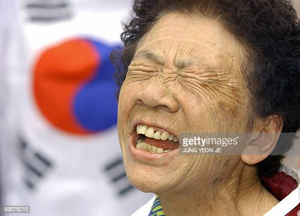 South Korean former comfort woman who was forced to serve as sex slave for Japaneses troops during World War II shouts a slogan during an antiJapan...