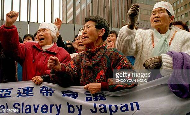 South Korean former comfort women chant antiJapan slogans during a demonstration in front of the Japanese embassy in Seoul 01 March The demonstration...