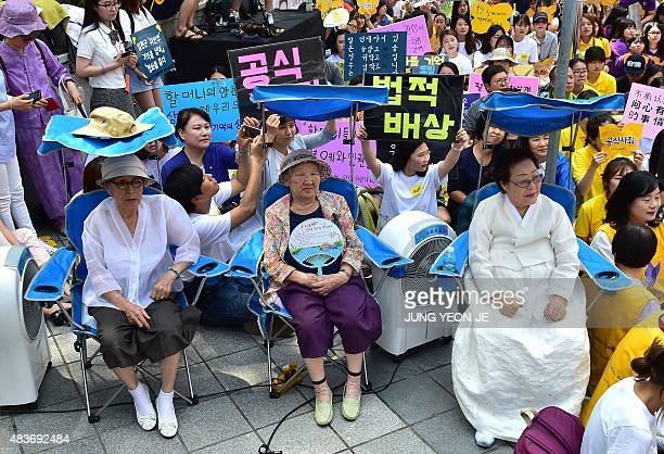 South Korean former 'comfort women' Kim BokDong Gil WonOk and Lee YongSoo who were forced to serve as sex slaves for Japanese troops during World War...