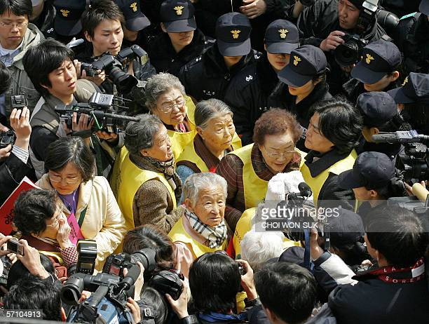 South Korean former comfort women who were forced to serve as sex slaves for Japanese troops during World War II are blocked by riot policemen as...