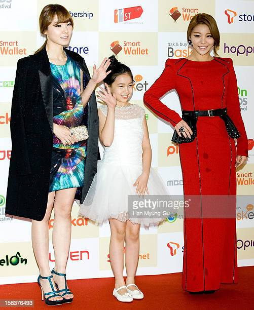 South Korean Gagwoman Shin BoRa actress Kim SuJung and singer Ailee arrive at the 2012 Melon Music Awards at Olympic Gymnasium on December 14 2012 in...