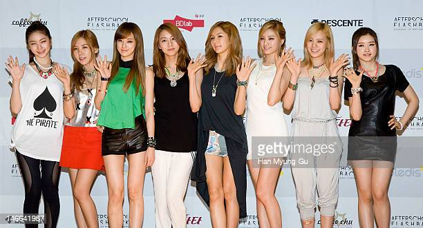 South Korean girl group Kaeun Raina Juyeon UIe JungANana Lizzy and EYoung of After School pose for media before a press conference to promote their...