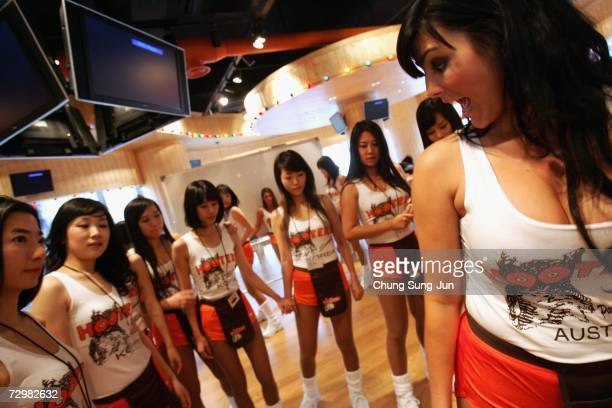 South Korean girls of Hooters undergo training at the Hooters restaurant on January 12, 2007 in Seoul, South Korea. The famous US restaurant is...